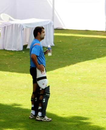 Gambhir watches his team-mates practice from the sidelines