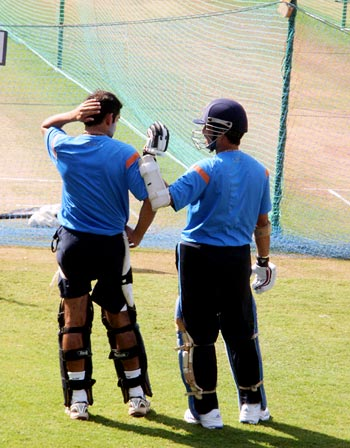 Sachin Tendulkar checks to see where Gambhir was struck