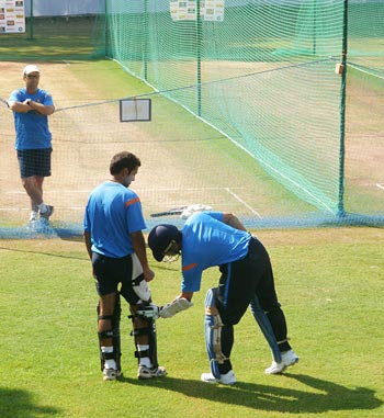 Tendulkar teaches Gambhir on how use his feet while playing the short delivery as coach Gary Kirsten watches from a distance
