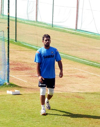 Captain MS Dhoni prepares to roll his arm in the nets