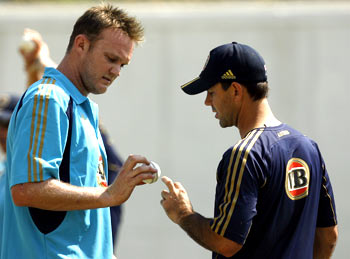 Ricky Ponting shares a few notes with Doug Bollinger during practice on Tuesday
