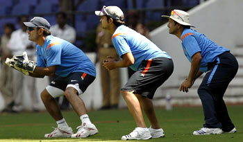 Captain MS Dhoni, Suresh Raina and Sachin Tendulkar during catching practice in Nagpur on Tuesday