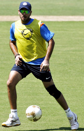 Yuvraj Singh plays football during a practice session on Tuesday