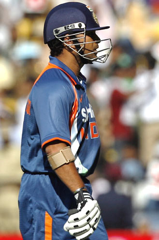 Sachin Tendulkar walks back to the pavillion after being dismissed for just four runs