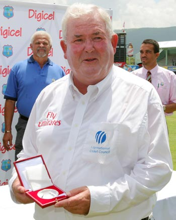 Umpire David Shepherd from England displays his match medal in Jamaica