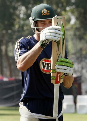 Shaun Marsh checks his bat before having a hit in the nets