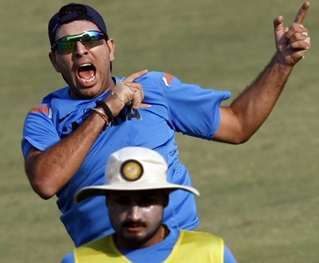 Yuvraj Singh celebrates after scoring in a football session at practice