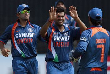 RP Singh is congratulated by team-mates