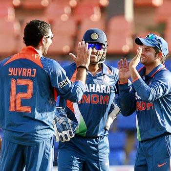 Yuvraj Singh (left) celebrates taking the wicket of Neil Broom