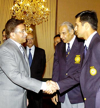 Pakistan president Pervez Musharraf (left) greets Indian captain Rahul Dravid as team manager Raj Singh Dungarpur looks on