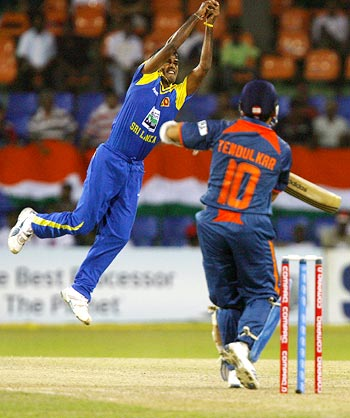 Nuwan Kulasekara tries to stop the hit by Sachin Tendulkar