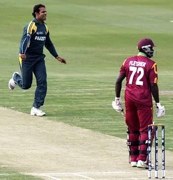 Naved-ul-Hasan celebrates the wicket of Andre Fletcher at an Indian Cricket League match.