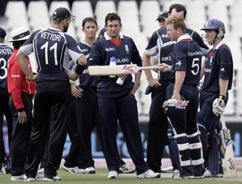 New Zealand players celebrate Collingwood's dismissal
