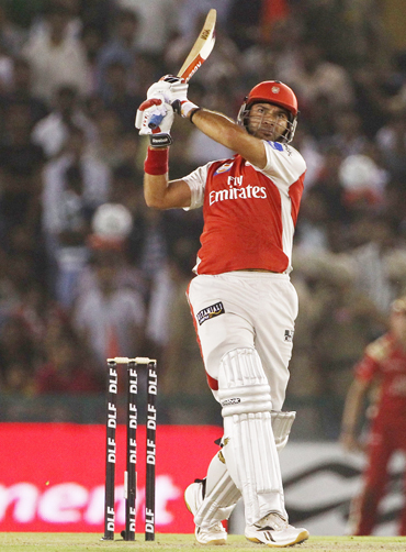 -Yuvraj Singh of the Kings XI Punjab hits a ball for six