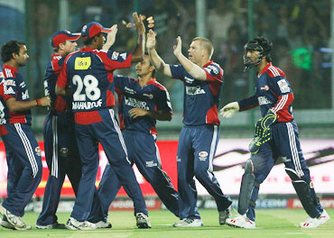 Delhi's player celebrate the wicket of Cameron White