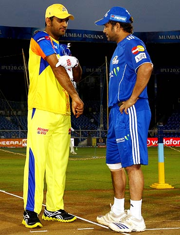 Mahendra Singh Dhoni with Sachin Tendulkar