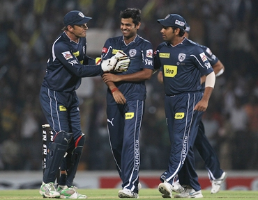 R P Singh is congratulated by teammates