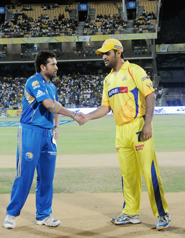 Sachin Tendulkar (L) captain of Mumbai Indians with Mahendra Singh Dhoni captainof Chennai Super Kings during the toss