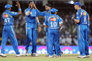 Mumbai Indians' players celebrate a wicket