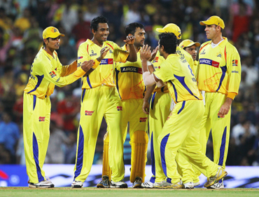 Thilan Thushara of the Chennai Super Kings is congratulated by team mates