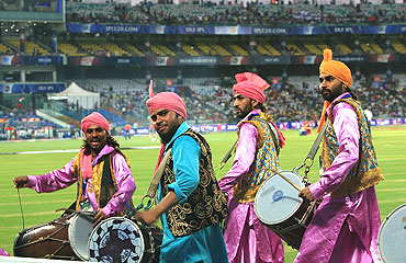 Men play the dhol during the match between Delhi Daredevils and Royal Challengers Bangalore