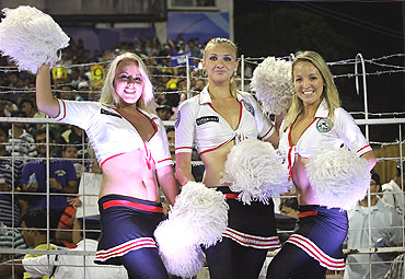 Cheerleaders pose for pictures after their dance routine