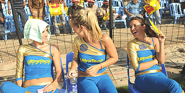 Cheerleaders relax between performances