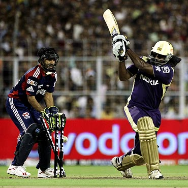 Chris Gayle is bowled by Rajat Bhatia