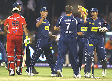 Deccan Chargers players congratulate bowler Ryan Harris after dismissing Manish Pandey