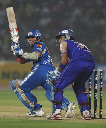 Sachin Tendulkar plays a sweep shot