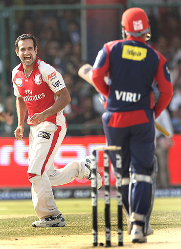 Irfan Pathan celebrates the wicket of Virender Sehwag