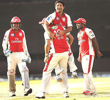 Piyush Chawla of the Kings celebrates with team-mates after picking Paul Collingwood