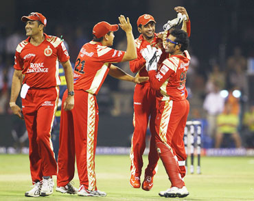 Bangalore players celebrate after a wicket