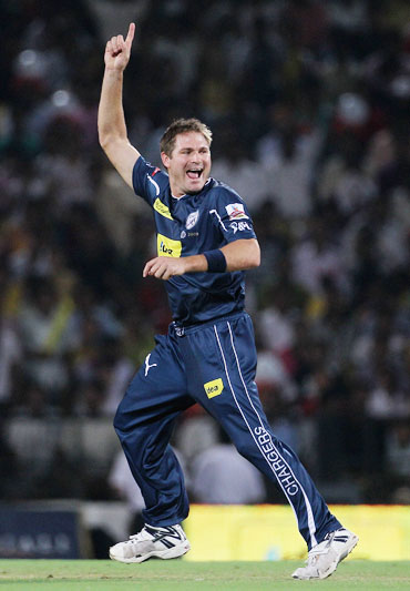 Ryan Harris celebrates after picking up Manish Pandey
