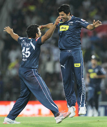 RP Singh and Rohit Sharma celebrates after picking up a wicket