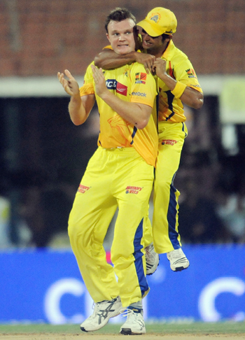 Suresh Raina of Chennai Super Kings celebrate with teammate Doug Bollinger