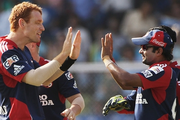 Andrew McDonald and Amit Mishra celebrate the wicket of Chandan Madan