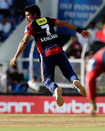 Pradeep Sangwan tries to field off his own bowling