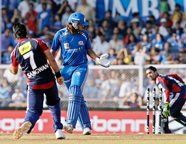 Saurabh Tiwary of the Mumbai Indians is clean bowled by Pradeep Sangwan