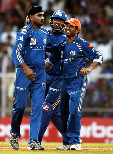 Harbhajan Singh celebrates with team mates after taking the wicket of Gautam Gambhir