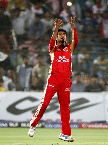 Manish Pandey is jubilant after taking the catch to dismiss Naman Ojha