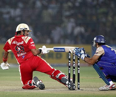 Robin Uthappa is stumped by Rajasthan Royals wicketkeeper Naman Ojha