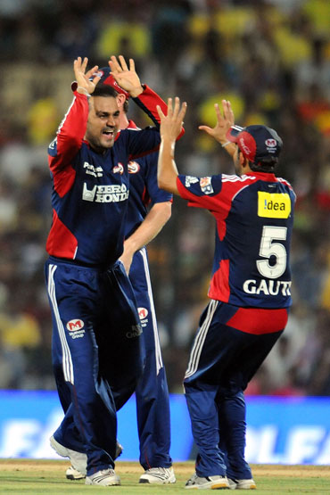 Virender Sehwag celebrates after picking up Mike Hussey