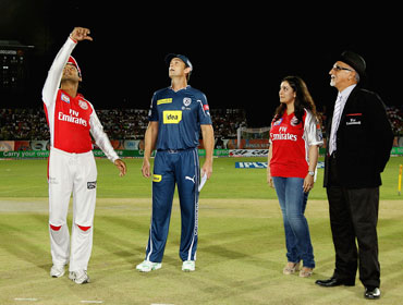 Kumar Sangakkara of the Kings XI tosses the coin with Adam Gilchrist of the Deccan Chargers