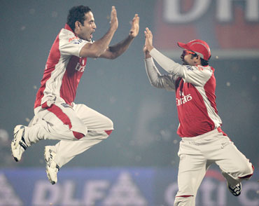 Irfan Pathan celebrates after picking Gilchirst