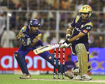 Sourav Ganguly (right) plays a shot on the leg side as Naman Ojha looks on