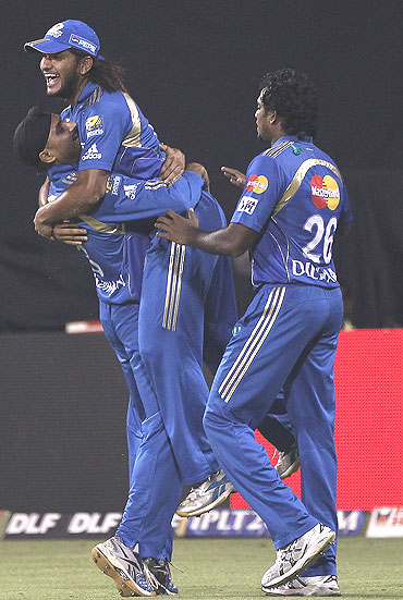 Harbhajan Singh reacts after picking up a wicket