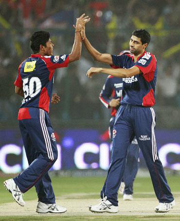Ashish Nehra celebrates after picking up Adam Gilchrist