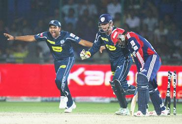 Dinesh Karthik is clean bowled by Pragyan Ojha