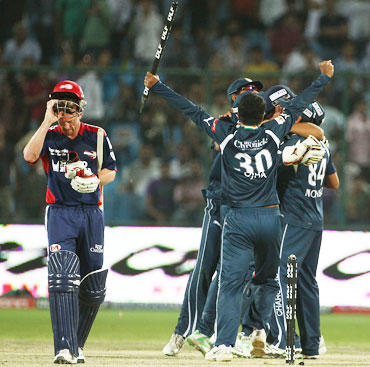 Deccan players celebrate after winning the match
